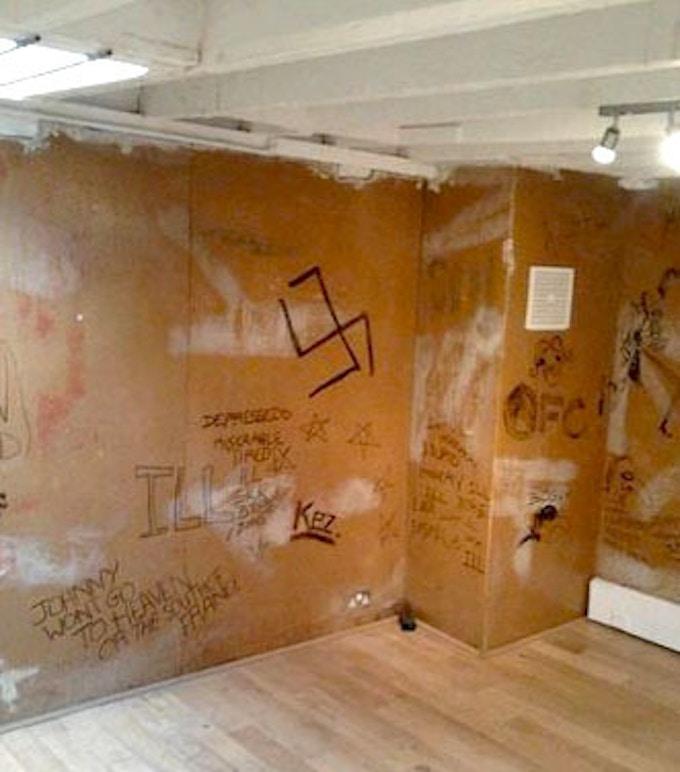 Graffitied walls of the Sex Pistol's rehearsal room