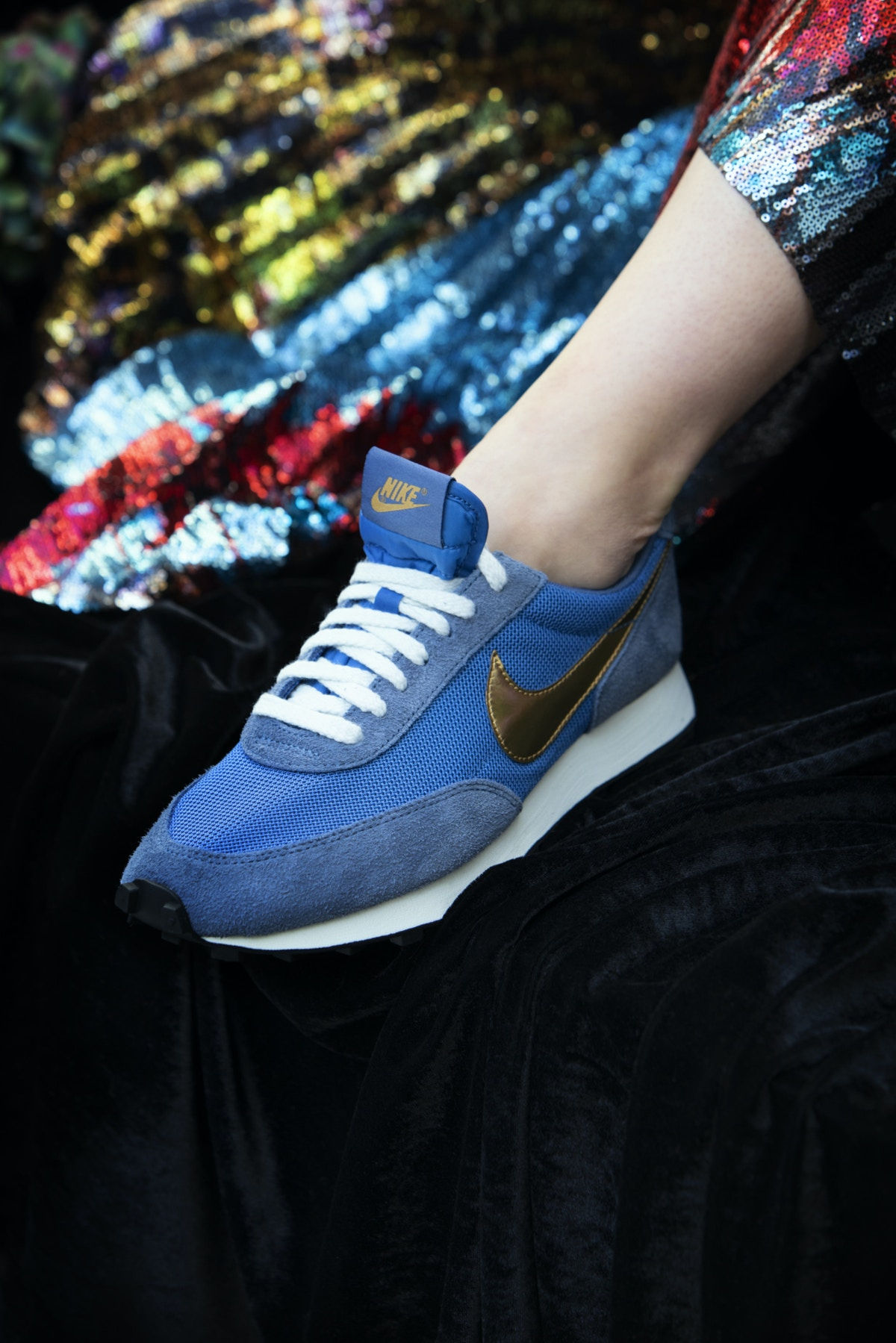 Close up of blue Nike trainers with gold detailing