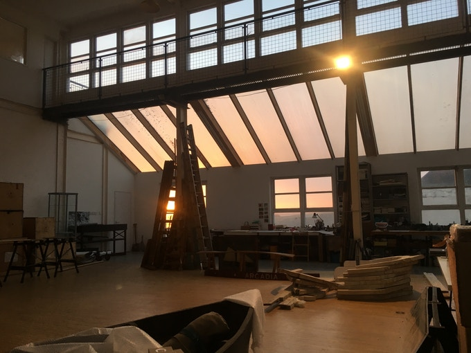 Interior of Kate Trouw's studio with sun setting in background