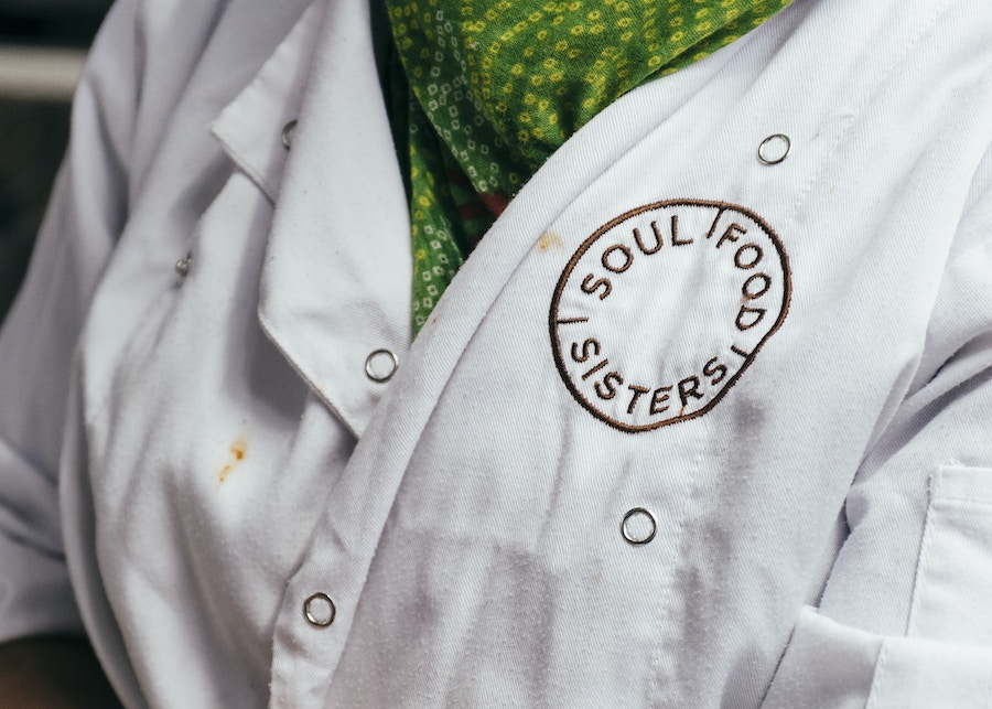 The Soul Food Sisters logo on a chefs apron