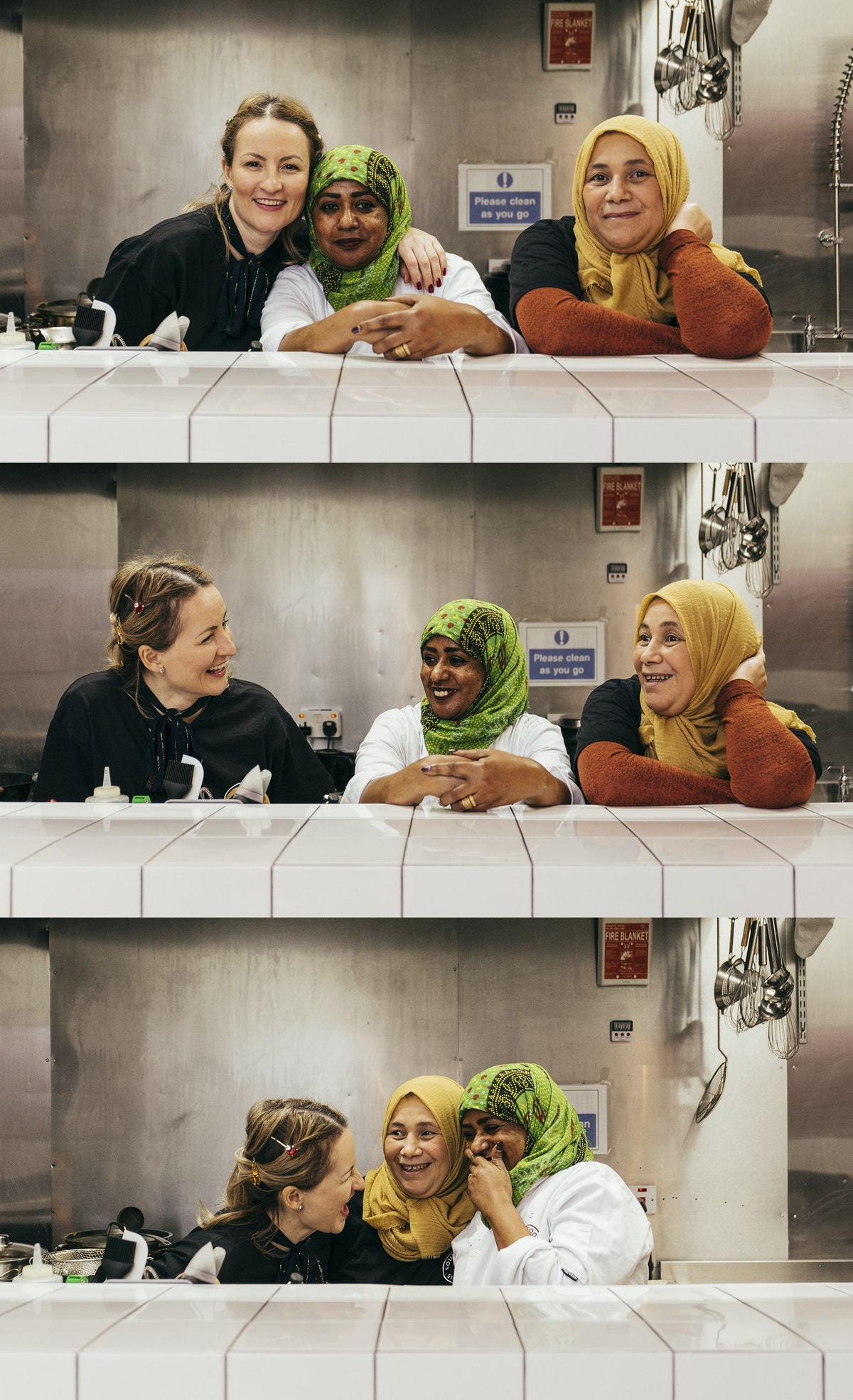 Three women of different nationalities talking and laughing.